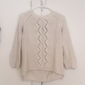 White sweater with button detail down the back
